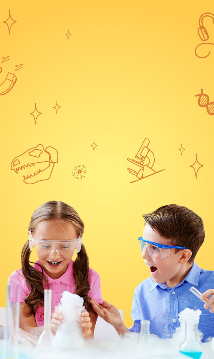 3 kids wearing protective goggles using flasks and test tubes